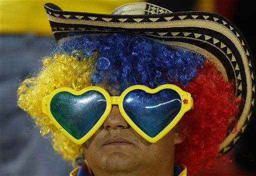 A Colombia&#39;s soccer  fan waits prior a U-20 World Cup round of 16 soccer match against Costa Rica in Bogota, Colombia, Tuesday, Aug. 9, 2011. &#40;AP Photo&#47;Fernando Llano&#41; <span class=meta>(AP Photo&#47; Fernando Llano)</span>