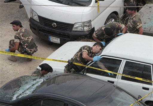 Lebanese army soldiers from the expert explosive unit, work in a parking lot where a bomb went off, in the north suburb of Beirut, Lebanon, on Thursday Aug. 11, 2011. A bomb went off in a north Beirut suburb, on Thursday, killing one person and wounding another. It was not immediately clear if the explosion in the busy suburb of Antelias was a roadside bomb or a hand grenade, the security officials said. &#40;AP Photo&#47;Hussein Malla&#41; <span class=meta>(AP Photo&#47; Hussein Malla)</span>