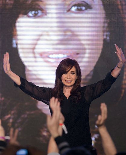 ALTERNATIVE CROP OF VC102 - Argentina&#39;s President and candidate for re-election Cristina Fernandez waves to supporters after the announcement of preliminary results of the primary elections in Buenos Aires, Argentina, Sunday Aug. 14, 2011. Exit polls show Fernandez with more than 45 percent of the vote against nine rivals in the country&#39;s first-ever open and simultaneous presidential primary ahead of the presidential election scheduled for Oct. 23. &#40;AP Photo&#47;Victor R. Caivano&#41; <span class=meta>(AP Photo&#47; Victor R. Caivano)</span>
