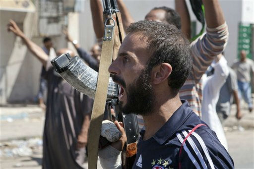 "<div class=""meta ""><span class=""caption-text "">In this Sunday, Aug. 14, 2011 photo, a Libyan rebel fighter in Zawiya, western Libya, reacts to the news that the city of Surman, an important strategic point, is now under the control of the rebel forces.  Libyan rebels have claimed they were trying to cut off two key supply routes to Moammar Gadhafi's stronghold in Tripoli after capturing more towns in the west of the country. On Sunday, the opposition fighters also battled government forces for control of the strategic city of Zawiya, just 30 miles (48 kilometers) from the capital, Tripoli. (AP Photo/Giulio Petrocco) (AP Photo/ Giulio Petrocco)</span></div>"