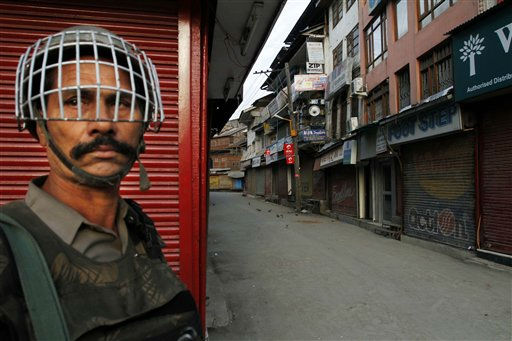 An Indian paramilitary soldier stands guard at a deserted market during a strike in Srinagar, India, Monday, Aug. 15, 2011. India marked 64 years of independence from British rule. &#40;AP Photo&#47;Mukhtar Khan&#41; <span class=meta>(AP Photo&#47; Mukhtar Khan)</span>