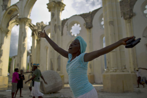 A woman prays during a procession honoring the Virgin Mary during Notre Dame celebrations at the earthquake damaged national cathedral in Port-au-Prince, Haiti, Monday, Aug. 15, 2011. &#40;AP Photo&#47;Ramon Espinosa&#41; <span class=meta>(Photo&#47;Ramon Espinosa)</span>