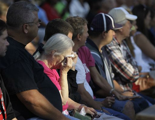Loretta Byrd reacts during a memorial service at the Indiana State Fair in Indianapolis, Monday, Aug. 15, 2011. The service was held for those killed in a weekend stage collapse at the fair.  Loretta&#39;s son Nathan Byrd died in the accident. &#40;AP Photo&#47;Darron Cummings&#41; <span class=meta>(AP Photo&#47; Darron Cummings)</span>