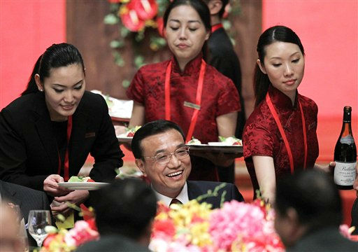 China&#39;s Vice Premier Li Keqiang, center, is served by attendants during a welcoming dinner at a hotel in Hong Kong Wednesday, Aug. 17, 2011. Li, who is widely expected to become China&#39;s next premier, announced a draft of measures to boost the service sector and financial industry, both pillars of Hong Kong&#39;s economy. His three-day visit to the city comes amid an upsurge in discontent among residents with the government&#39;s management of the economy. &#40;AP Photo&#47;Vincent Yu, Pool&#41; <span class=meta>(AP Photo&#47; Vincent Yu)</span>