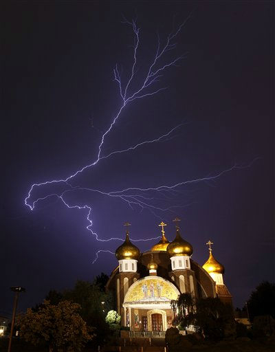 "<div class=""meta ""><span class=""caption-text "">Lightning spreads across the sky over the Russian Orthodox Church of Three Saints in Garfield, N.J., during a storm on Thursday, Aug. 18, 2011. (AP Photo/Julio Cortez) (AP Photo/ Julio Cortez)</span></div>"