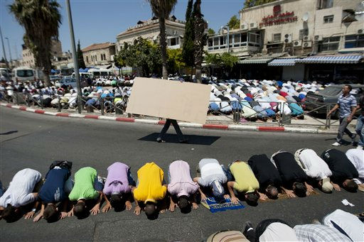 "<div class=""meta ""><span class=""caption-text "">Palestinian Muslim worshipers prevented from entering the Al-Aqsa Mosque pray outside Damascus Gate in Jerusalem's Old City during Friday prayers of the Muslim holy month of Ramadan, Aug. 19, 2011. Dozens of Palestinians trying to reach the Al-Aqsa Mosque in Jerusalem for Muslim prayers during the Muslim holy month of Ramadan scuffled with police at one of the gates to the Old City. The police were allowing access only to older Muslims in a measure police said is meant to prevent unrest. (AP Photo/Sebastian Scheiner) (AP Photo/ Sebastian Scheiner)</span></div>"