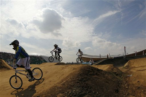 Backdropped by the velodrome elite women riders practice on the track during the BMX Supercross World Cup at the Olympic Park&#39;s BMX Track in London, Friday, Aug. 19, 2011. The course will host the London 2012 Olympic BMX competition next year. &#40;AP Photo&#47;Sang Tan&#41; <span class=meta>(AP Photo&#47; Sang Tan)</span>