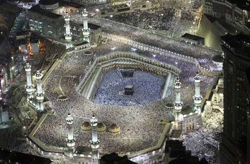 "<div class=""meta ""><span class=""caption-text "">A general view shows hundreds of thousands of Muslims circle the Kaaba inside and outside the Grand Mosque in Mecca, Saudi Arabia, late Saturday, Aug. 20, 2011. Nearly three million Muslims attended to pray at the Grand Mosque in Macca and the Prophet Mosque in Madinah during Ramadan. (AP Photo) (AP Photo/ STR)</span></div>"
