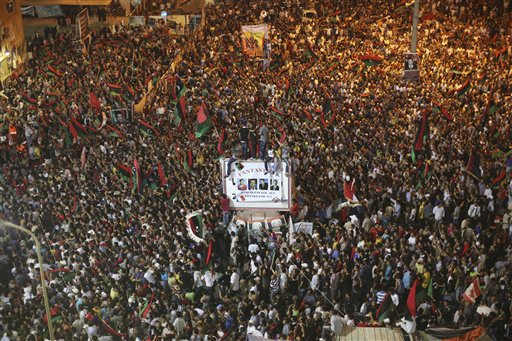 "<div class=""meta ""><span class=""caption-text "">People celebrate the capture in Tripoli of Moammar Gadhafi's son and one-time heir apparent, Seif al-Islam, at the rebel-held town of Benghazi, Libya, early Monday, Aug. 22, 2011. Libyan rebels raced into Tripoli in a lightning advance Sunday that met little resistance as Moammar Gadhafi's defenders melted away and his 40-year rule appeared to rapidly crumble. The euphoric fighters celebrated with residents of the capital in the city's main square, the symbolic heart of the regime. (AP Photo/Alexandre Meneghini) (AP Photo/ Alexandre Meneghini)</span></div>"