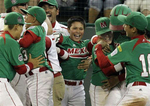 Mexicali, Mexico&#39;s Bruco Ruiz, center, celebrates with his team after hitting the game-winning walk-off single, scoring Jorge Jacobo, in the seventh inning of a baseball game against Hamamatsu City, Japan, during international pool play at the Little League World Series in South Williamsport, Pa., Sunday, Aug. 21, 2011. Mexico won 3-2 in seven innings.&#40;AP Photo&#47;Gene J. Puskar&#41; <span class=meta>(AP Photo&#47; Gene J. Puskar)</span>