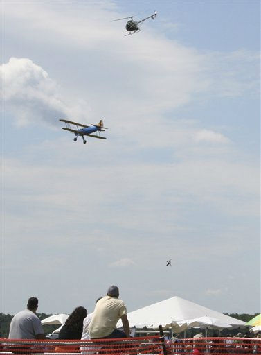 Wing walker Todd Green falls to his death after attempting to move from a plane to a helicopter during an air show in Harrison Township, Mich. Sunday, Aug. 21, 2011. &#40;AP Photo&#47;Jeremy Mitchell&#41; <span class=meta>(AP Photo&#47; Jeremy Mitchell)</span>