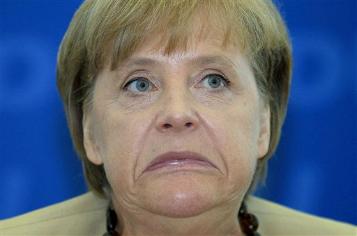 German Chancellor Angela Merkel reacts at the beginning of the weekly board meeting of the German Christian Democratic party in Berlin, Germany, Monday, Aug. 22, 2011. &#40;AP Photo&#47;Michael Sohn&#41; <span class=meta>(AP Photo&#47; Michael Sohn)</span>