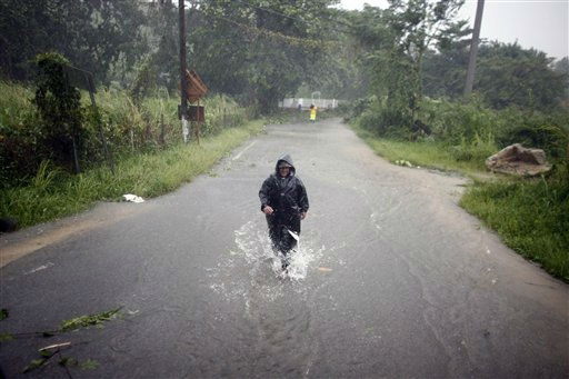 A man wades through a flooded street after hurricane Irene hit the area in Naguabo, Puerto Rico, Monday, Aug. 22, 2011. Hurricane Irene headed out over warm ocean water on a path that could take it to northeastern Dominican Republic and part of Haiti early Tuesday and to the U.S. mainland by the end of the week. &#40;AP Photo&#47;Ricardo Arduengo&#41; <span class=meta>(AP Photo&#47; Ricardo Arduengo)</span>
