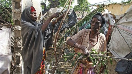 "<div class=""meta ""><span class=""caption-text "">Somali women from southern Somalia construct a makeshift shelter from branches of tree outside a destroyed building in Mogadishu Somalia, Monday,  Aug.  22, 2011. The United Nations says more than 3.2 million Somalis need food aid. The U.S. says 29,000 Somali children under age 5 have died. .(AP Photo/Farah Abdi Warsameh) (AP Photo/ Farah Abdi Warsameh)</span></div>"