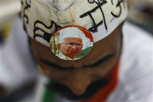 A supporter sports a badge with India&#39;s anti-corruption activist Anna Hazare&#39;s photograph as he joins others to support Hazare on the 8th day of his hunger strike in New Delhi, India, Tuesday, Aug. 23, 2011. The government called Tuesday for India&#39;s political parties to reach consensus on drafting anti-corruption legislation, as an activist leading anti-graft protests entered the second week of his hunger strike. &#40;AP Photo&#47;Saurabh Das&#41; <span class=meta>(AP Photo&#47; Saurabh Das)</span>