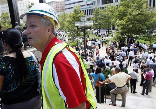 "<div class=""meta ""><span class=""caption-text "">A worker with Baltimore Gas and Electric walks past a square where workers wait for word to re-enter their office buildings after an earthquake was felt in Baltimore on Tuesday, Aug. 23, 2011. Downtown office buildings were cleared and workers were waiting for clearance to re-enter. (AP Photo/Patrick Semansky) (AP Photo/ Patrick Semansky)</span></div>"