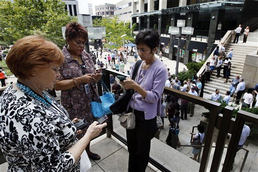 "<div class=""meta ""><span class=""caption-text "">People check their phones as they wait outside of an office building after an earthquake was felt in Baltimore, Tuesday, Aug. 23, 2011. Downtown office buildings were cleared and workers were waiting for clearance to re-enter. (AP Photo/Patrick Semansky) (AP Photo/ Patrick Semansky)</span></div>"