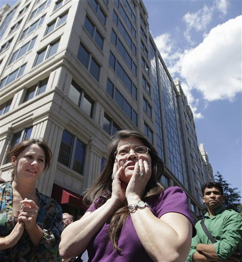 "<div class=""meta ""><span class=""caption-text "">Susy Ward, center, and other office workers gather on the sidewalk in downtown Washington moments after an earthquake shook the nation's capitol, Tuesday, Aug. 23, 2011. The 5.9 magnitude earthquake centered northwest of Richmond, Va., shook much of Washington, D.C., and was felt as far north as Rhode Island and New York City.   (AP Photo/J. Scott Applewhite) (AP Photo/ J. Scott Applewhite)</span></div>"