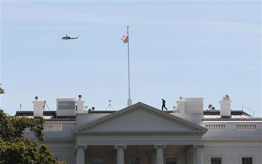 "<div class=""meta ""><span class=""caption-text "">US Park Service helicopter patrols over the White House in Washington, Tuesday, Aug. 23, 2011, as a member of the Secret Service walks across the roof of the White House following an earthquake in the Washington area. The 5.9 magnitude earthquake centered northwest of Richmond, Va., shook much of Washington, D.C., and was felt as far north as Rhode Island and New York City.  (AP Photo/Pablo Martinez Monsivais) (AP Photo/ Pablo Martinez Monsivais)</span></div>"