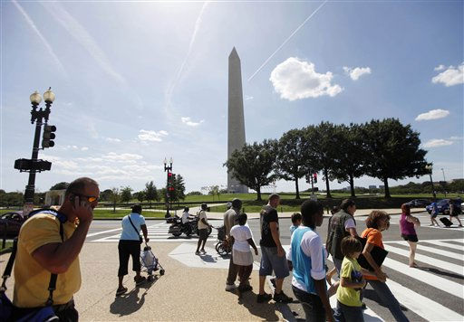 "<div class=""meta ""><span class=""caption-text "">With the Washington Monument in the background people walk nearby after it was closed to visitors as a security precaution following an earthquake in the Washington area. The 5.9 magnitude earthquake centered northwest of Richmond, Va., shook much of Washington, D.C., and was felt as far north as Rhode Island and New York City.  (AP Photo/Pablo Martinez Monsivais) (AP Photo/ Pablo Martinez Monsivais)</span></div>"