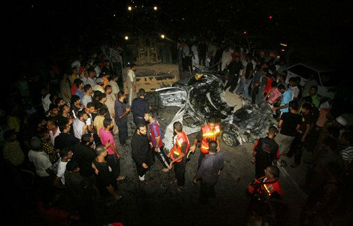 Palestinians look at the wreckage of a car  after it was hit by an Israeli missile strike killing an Islamic Jihad militant in Rafah, southern Gaza Strip, early Wednesday, Aug. 24, 2011. The Israeli military said the gunman had smuggled weapons into Gaza and was involved in militant activity in Egypt&#39;s Sinai peninsula, near Israel&#39;s southern border.&#40;AP Photo&#47;Eyad Baba&#41; <span class=meta>(AP Photo&#47; Eyad Baba)</span>