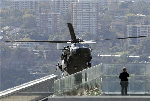 A man watches an Australian Army Blackhawk popping up between buildings during counter terrorism exercises over the Central Business District in Sydney, Australia, Wednesday, Aug. 24, 2011. &#40;AP Photo&#47;Rob Griffith&#41; <span class=meta>(AP Photo&#47; Rob Griffith)</span>