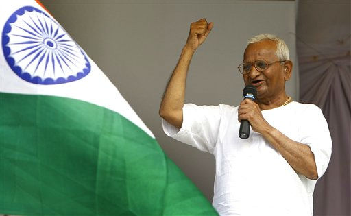India&#39;s anti-corruption activist Anna Hazare speaks to the crowd during his hunger strike in New Delhi, India, Thursday, Aug. 25, 2011. Indian Prime Minister Manmohan Singh seized control of a national anti-corruption debate Thursday, calling on Parliament to discuss protesters&#39; reform proposals and appealing to the weakening 74-year-old activist to end his hunger strike. &#40;AP Photo&#47;Gurinder Osan&#41; <span class=meta>(AP Photo&#47; Gurinder Osan)</span>
