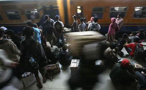 "<div class=""meta ""><span class=""caption-text "">Indonesians wait to board a train to leave for their homes at Senen train station Thursday, Aug. 25, 2011 in Jakarta, Indonesia. The mass exodus out of the capital and other major cities in the country is underway as thousands are preparing to head homes to celebrate Eid al-Fitr holiday. The holiday marks the end of the holy fasting month of Ramadan. (AP Photo/Achmad Ibrahim) (AP Photo/ Achmad Ibrahim)</span></div>"