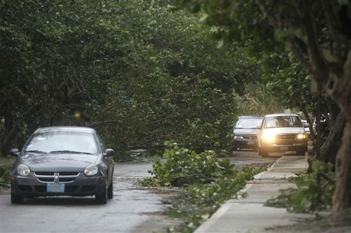 Cars wind their way around downed trees on the coastal road in the aftermath of Hurricane Irene in Nassau, on New Providence Island in the Bahamas, Thursday, Aug. 25, 2011. Irene hit Nassau with tropical storm strength winds as it passed to the east.  &#40;AP Photo&#47;Lynne Sladky&#41; <span class=meta>(AP Photo&#47; Lynne Sladky)</span>
