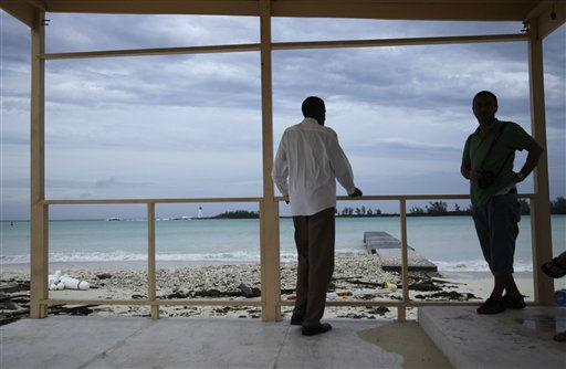 Men look out at  a calming sea in the aftermath of Hurricane Irene in Nassau, on New Providence Island in the Bahamas, Thursday, Aug. 25, 2011. Irene hit Nassau with tropical storm strength winds as it passed to the east.  &#40;AP Photo&#47;Lynne Sladky&#41; <span class=meta>(AP Photo&#47; Lynne Sladky)</span>