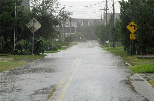 Heavy rains from Hurricane Irene flood an ocean front street in Pawleys Island, S.C., on Friday, Aug. 26, 2011. State officials say strong winds, heavy rain and some flooding is expected in Horry and Georgetown counties Friday.  &#40;AP Photo&#47;Bruce Smith&#41; <span class=meta>(AP Photo&#47; Bruce Smith)</span>