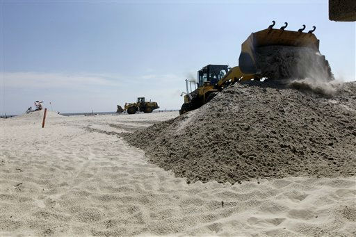 "<div class=""meta ""><span class=""caption-text "">Front loaders build sand dunes to hold the surf back in preparation for Hurricane Irene, Friday, Aug. 26, 2011 in Long Beach, N.Y.  Long Island residents in the path of Hurricane Irene girded for wind, rain and flooding as the storm stood poised to bear down on an already saturated New York state.  Irene has the potential to cause billions of dollars in damage all along a densely populated arc that includes Washington, Baltimore, Philadelphia, New York, Boston and beyond. At least 65 million people could be affected. (AP Photo/Mary Altaffer) (AP Photo/ Mary Altaffer)</span></div>"