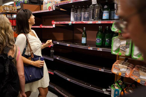 "<div class=""meta image-caption""><div class=""origin-logo origin-image ""><span></span></div><span class=""caption-text"">A shopper hunts for water bottles among the empty shelves at a downtown Manhattan supermarket where workers claim over 400 cases were purchased in a few hours, Friday, Aug. 26, 2011, in New York. Mayor Bloomberg advised all New Yorkers to gather supplies as the region girded for wind, rain, and flooding as the storm stood poised to bear down on an already saturated New York state. (AP Photo/John Minchillo) (AP Photo/ John Minchillo)</span></div>"