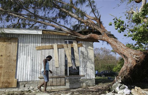 Lena Mae Wright walks in the backyard of her home where a tree fell as a result of Hurricane Irene, on Cat Island in the Bahamas, Friday, Aug. 26, 2011. Wright had evacuated from her home to stay with a friend as Irene hit Cat Island Wednesday night. Residents began cleaning up the damage caused by Irene and shopkeepers started taking boards off their shops&#39; windows Friday. &#40;AP Photo&#47;Lynne Sladky&#41; <span class=meta>(AP Photo&#47; Lynne Sladky)</span>