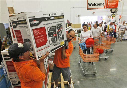 "<div class=""meta ""><span class=""caption-text "">Home Depot employees, Richard Howell, left, and Farid Elattar, right, load up emergency generators for Virginia Beach residents in preparation for the arrival of Hurricane Irene in  Virginia Beach , Va., Friday, Aug. 26, 2011.  Hurricane Irene is expected to hit the area Saturday.  (AP Photo/Steve Helber) (AP Photo/ Steve Helber)</span></div>"