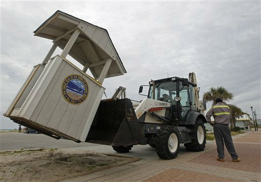 Town workers remove a parking hut near the beach in Atlantic Beach, N.C., Friday, Aug. 26, 2011, as Hurricane Irene heads toward the North Carolina coast. &#40;AP Photo&#47;Chuck Burton&#41; <span class=meta>(AP Photo&#47; Chuck Burton)</span>
