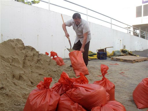 Al Reichenbach, a facilties worker at Resorts Casino Hotel in Atlantic City, NJ, fills one of 400 sandbags the casino is deploying on Friday Aug. 236, 2011 to protect it from Hurricane Irene. Atlantic City&#39;s 11 casinos are starting to shut down as Hurricane Irene threatens the nation&#39;s second-largest gambling resort. &#40;AP Photo&#47;Wayne Parry&#41; <span class=meta>(AP Photo&#47; Wayne Parry)</span>