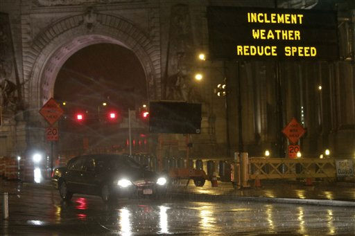 A road sign warns of inclement weather as  car drives west off the Manhattan bridge onto Canal St. in Lower Manhattan, Saturday, Aug. 27, 2011.  Mayor Bloomberg advised all New Yorkers to prepare as the region girded for wind, rain, and flooding as the storm stood poised to bear down on an already saturated New York state. &#40;AP Photo&#47;Mary Altaffer&#41; <span class=meta>(AP Photo&#47; Mary Altaffer)</span>
