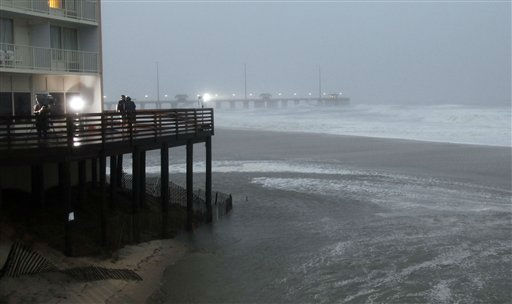"<div class=""meta ""><span class=""caption-text "">Waves move onto the beach as the Hurricane Irene approaches in Nags Head, N.C., Saturday, Aug. 27, 2011. Irene slammed into North Carolina's coast around dawn Saturday with howling winds and drenching rains amid reports of flooding and tens of thousands of people without power. (AP Photo/Gerry Broome) (AP Photo/ Gerry Broome)</span></div>"