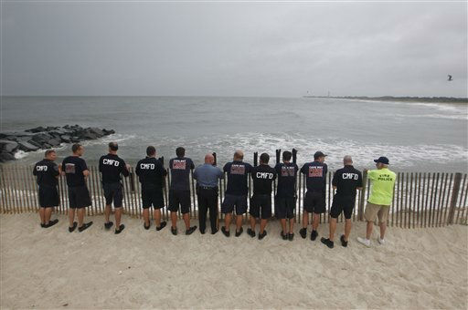 "<div class=""meta ""><span class=""caption-text "">Members of Cape May Fire Department look look out at a stormy Atlantic early Saturday, Aug. 27, 2011, in Cape May, N.J. , as Hurricane Irene approaches. Hurricane-force winds and drenching rains from Irene battered the North Carolina coast early Saturday as the storm began its potentially catastrophic run up the Eastern Seaboard. (AP Photo/Mel Evans) (AP Photo/ Mel Evans)</span></div>"