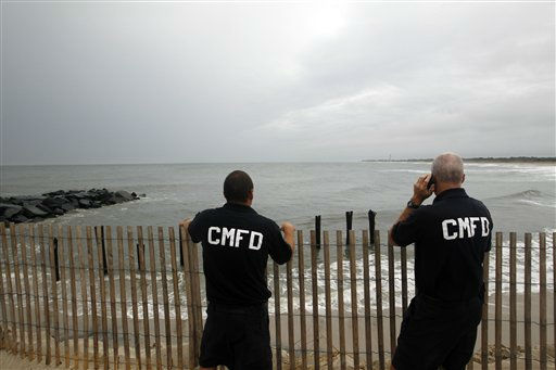 "<div class=""meta ""><span class=""caption-text "">Cape May fire chief Jerry Inderwies, right, stands with firefighter Dave Jackson as they look out at a stormy Atlantic early Saturday, Aug. 27, 2011, in Cape May, N.J. , as Hurricane Irene approaches. Hurricane-force winds and drenching rains from Irene battered the North Carolina coast early Saturday as the storm began its potentially catastrophic run up the Eastern Seaboard. (AP Photo/Mel Evans) (AP Photo/ Mel Evans)</span></div>"