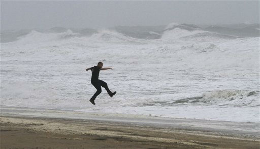 A Virginia Beach visitor jumps into the ocean as Hurricane Irene hits Virginia Beach , Va., Saturday, Aug. 27, 2011. &#40;AP Photo&#47;Steve Helber&#41; <span class=meta>(AP Photo&#47; Steve Helber)</span>