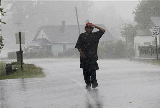 Antoine White walks in the effects of Hurricane Irene in Elizabeth City, N.C., Saturday, Aug. 27, 2011 as the storm moves up the North Carolina coast.  &#40;AP Photo&#47;Jim R. Bounds&#41; <span class=meta>(AP Photo&#47; Jim R. Bounds)</span>
