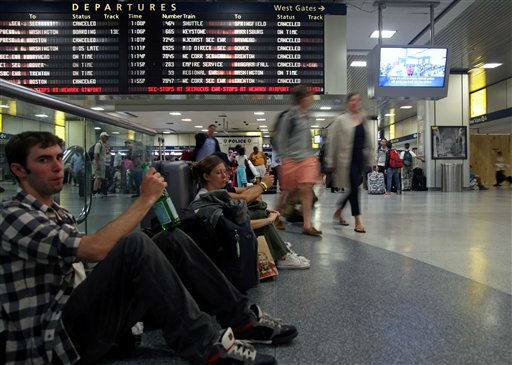 Collin Morrison, left, Vancouver, British Columbia, waits for a train at Penn Station in New York, where there is limited transportation due to Hurricane Irene, Saturday, Aug. 27, 2011, in New York. &#40;AP Photo&#47;Chelsea Matiash&#41; <span class=meta>(AP Photo&#47; Chelsea Matiash)</span>