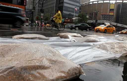 Sandbags line drains along 8th Avenue in New York in preparation for Hurricane Irene, Saturday, Aug. 27, 2011, in New York. &#40;AP Photo&#47;Chelsea Matiash&#41; <span class=meta>(AP Photo&#47; Chelsea Matiash)</span>