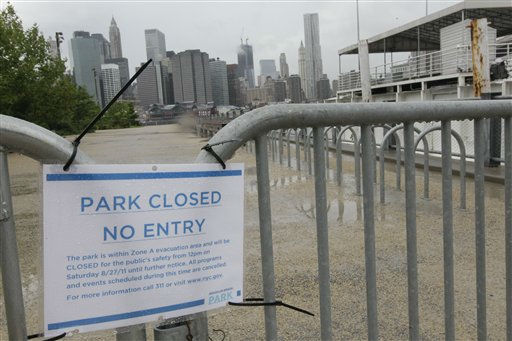 The lower Manhattan skyline is seen behind a sign announces the closure of Brooklyn Bridge park in the Dumbo neighborhood of the Brooklyn borough of New York, Saturday, Aug. 27, 2011.  Hurricane Irene opened its assault on the Eastern Seaboard on Saturday by lashing the North Carolina coast with wind as strong as 115 mph &#40;185 kph&#41; and pounding shoreline homes with waves. Farther north, Philadelphia and New York City-area authorities readied a massive shutdown of trains and airports, with 2 million people ordered out of the way.&#40;AP Photo&#47;Mary Altaffer&#41; <span class=meta>(AP Photo&#47; Mary Altaffer)</span>