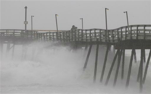 Denis Hromin, a concerned fisherman, checks on Avalon Fishing Pier as it lost some pilings after being battered by wind and waves on the Outer Banks in Kill Devil Hills, N.C., Saturday, Aug. 27, 2011 as Hurricane Irene reaches the North Carolina coast. &#40;AP Photo&#47;Charles Dharapak&#41; <span class=meta>(AP Photo&#47; Charles Dharapak)</span>