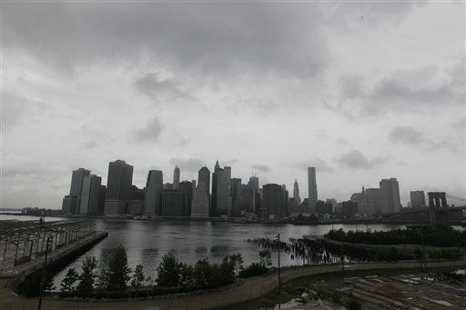 Storm clouds loom over lower Manhattan, Saturday, Aug. 27, 2011 in New York.  Hurricane Irene opened its assault on the Eastern Seaboard on Saturday by lashing the North Carolina coast with wind as strong as 115 mph &#40;185 kph&#41; and pounding shoreline homes with waves. Farther north, Philadelphia and New York City-area authorities readied a massive shutdown of trains and airports, with 2 million people ordered out of the way.&#40;AP Photo&#47;Mary Altaffer&#41; <span class=meta>(AP Photo&#47; Mary Altaffer)</span>
