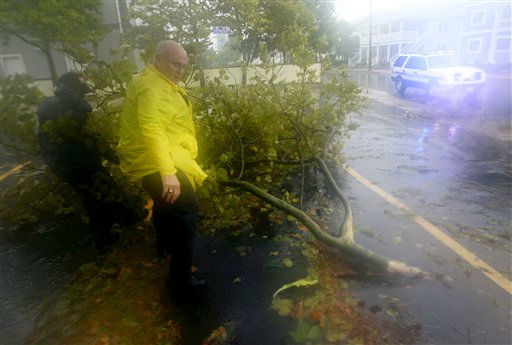 Members of the Ocean City Police Department clear a fallen tree branch from a street in Ocean City, Md., Saturday, Aug. 27, 2011, as Hurricane Irene heads toward the Maryland coast. Hurricane Irene knocked out power and piers in North Carolina, clobbered Virginia with wind and churned up the coast Saturday to confront cities more accustomed to snowstorms than tropical storms.  &#40;AP Photo&#47;Patrick Semansky&#41; <span class=meta>(AP Photo&#47; Patrick Semansky)</span>