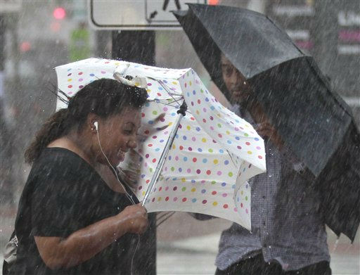 Pedestrians with umbrellas struggle against a blast of wind and rain from Hurricane Irene in downtown Washington late Saturday afternoon, Aug. 27, 2011. &#40;AP Photo&#47;J. Scott Applewhite&#41; <span class=meta>(AP Photo&#47; J. Scott Applewhite)</span>